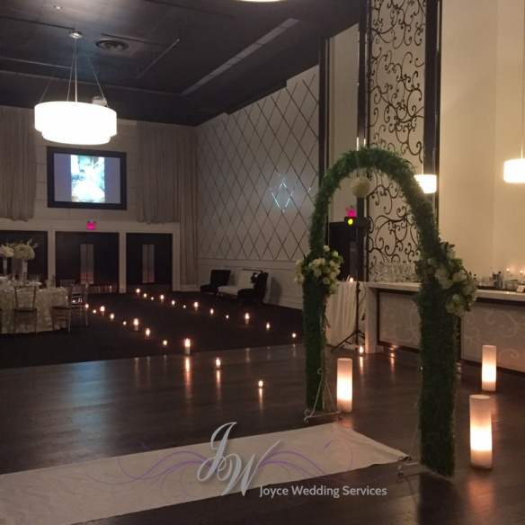 candle runner arch grand luxe ceremony.jpg